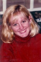 Paula Headshot homepage red sweater